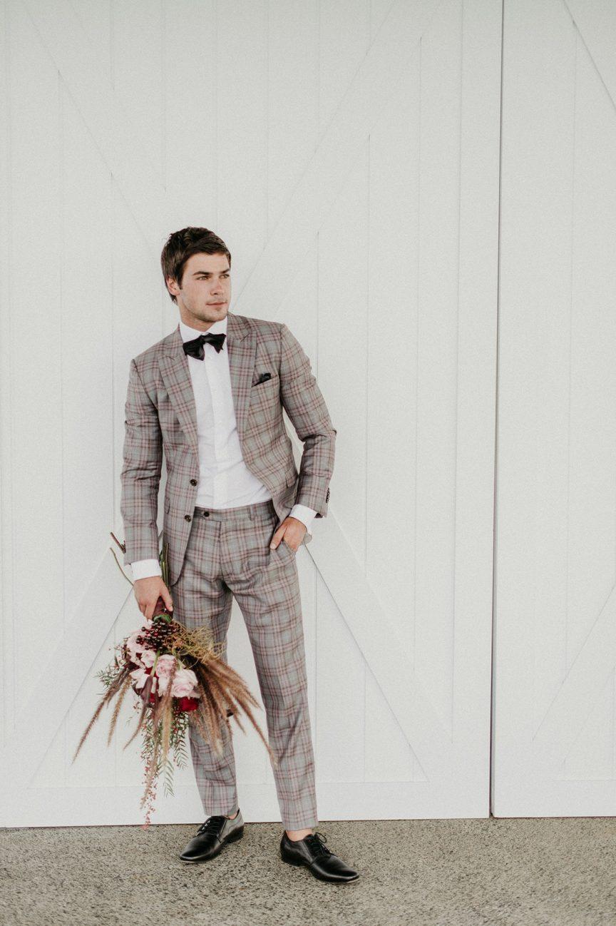 groom in plaid suit