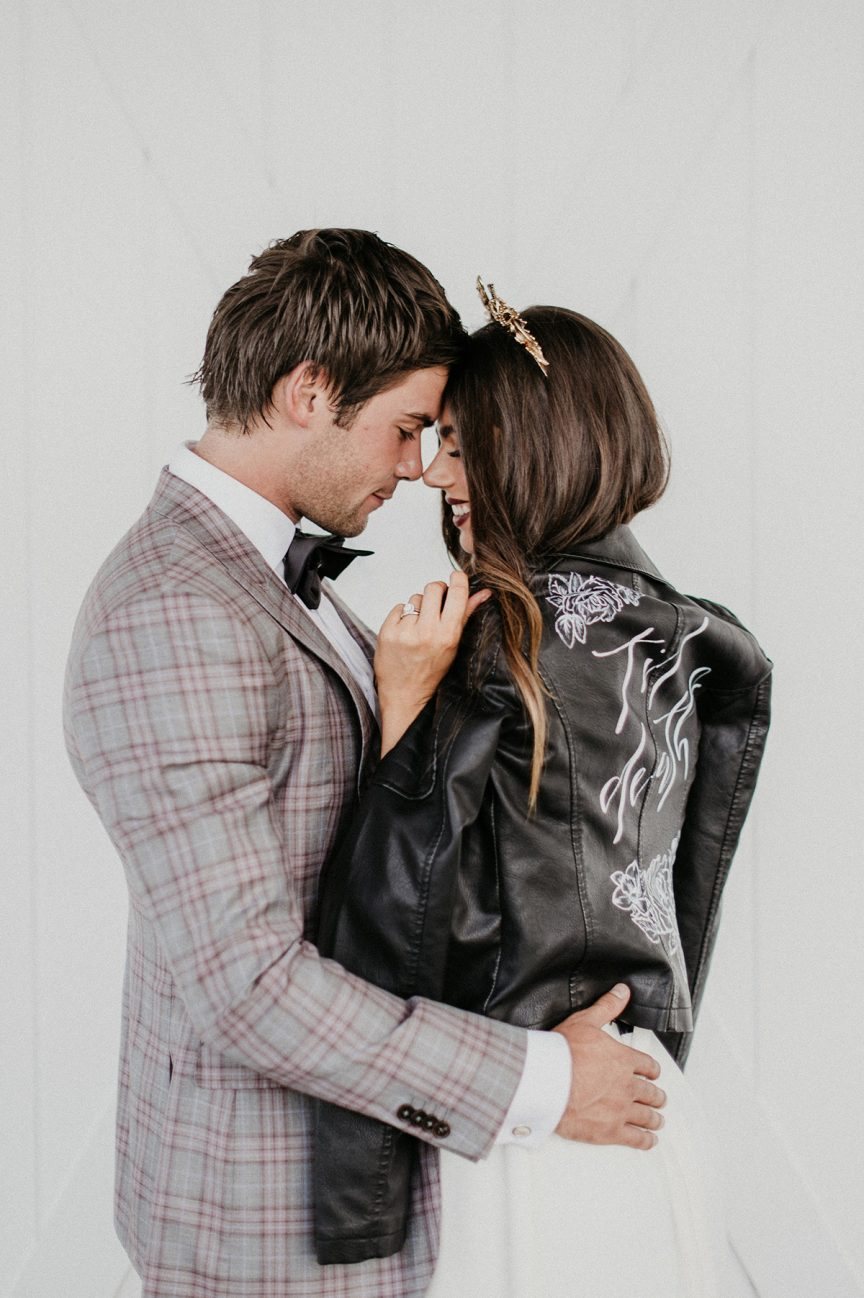 bride and groom with leather jacket