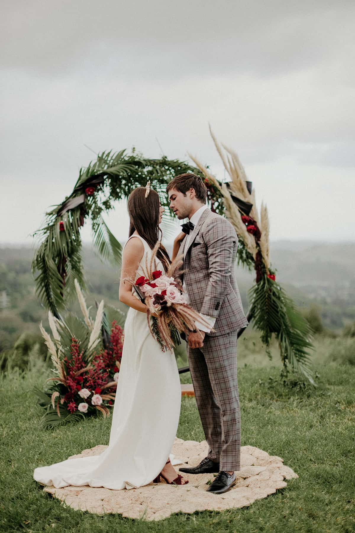 couple with circle wedding arbour