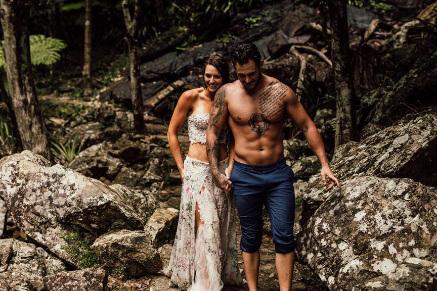 Couple walking in rainforest