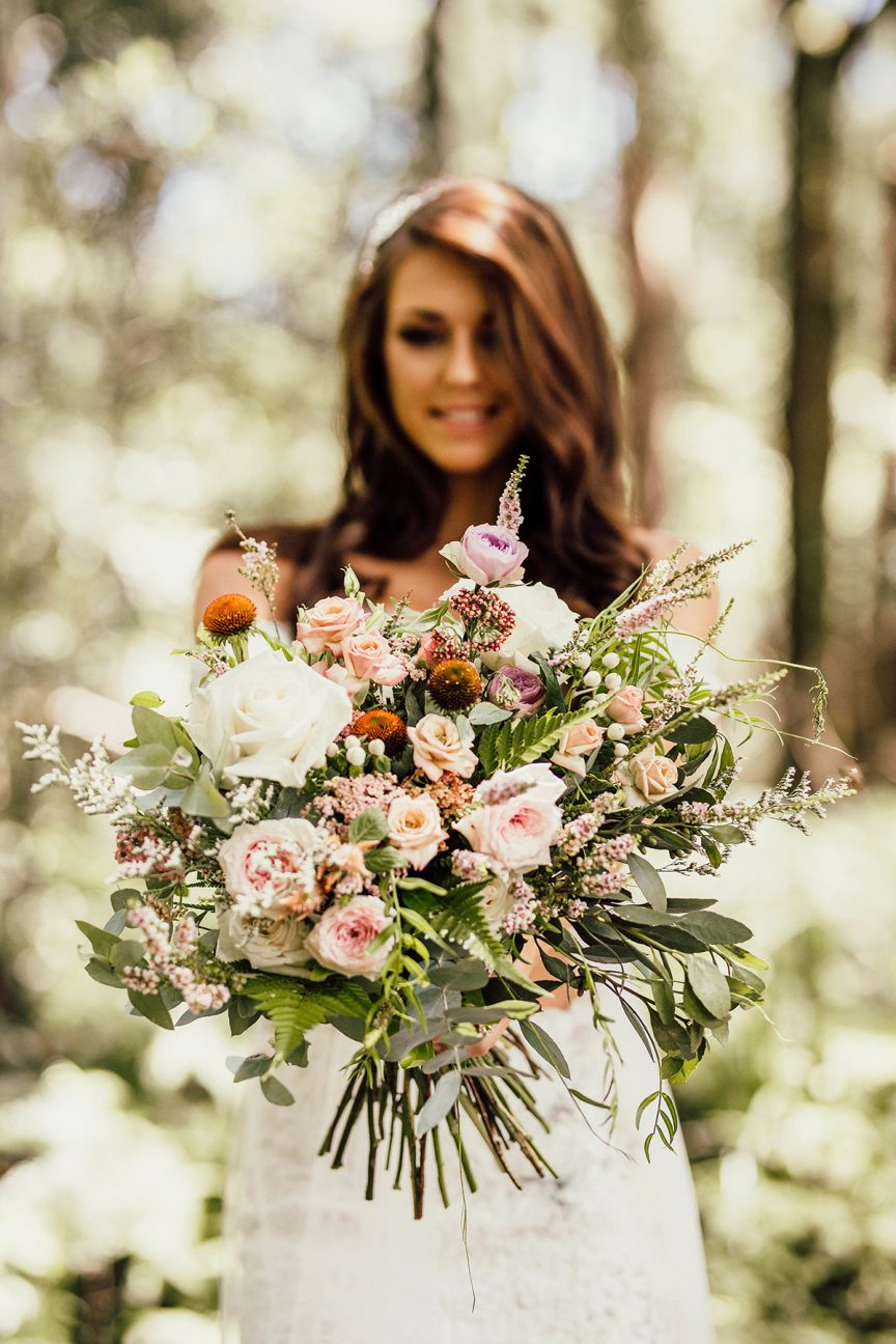 Bride with bouquet in rainforest