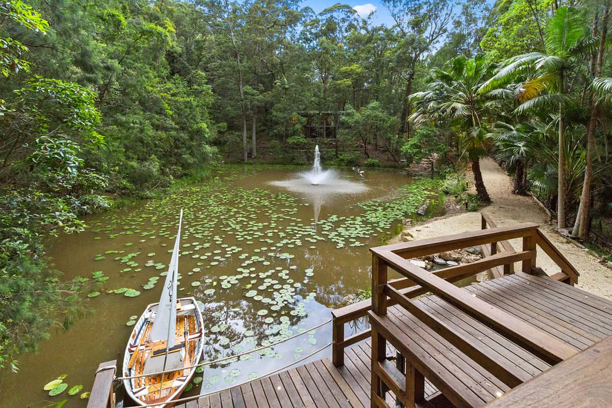 Mistere-honeymoon-story-Mistere-Spa-and-Retreat-pond-deck-fountain-boat
