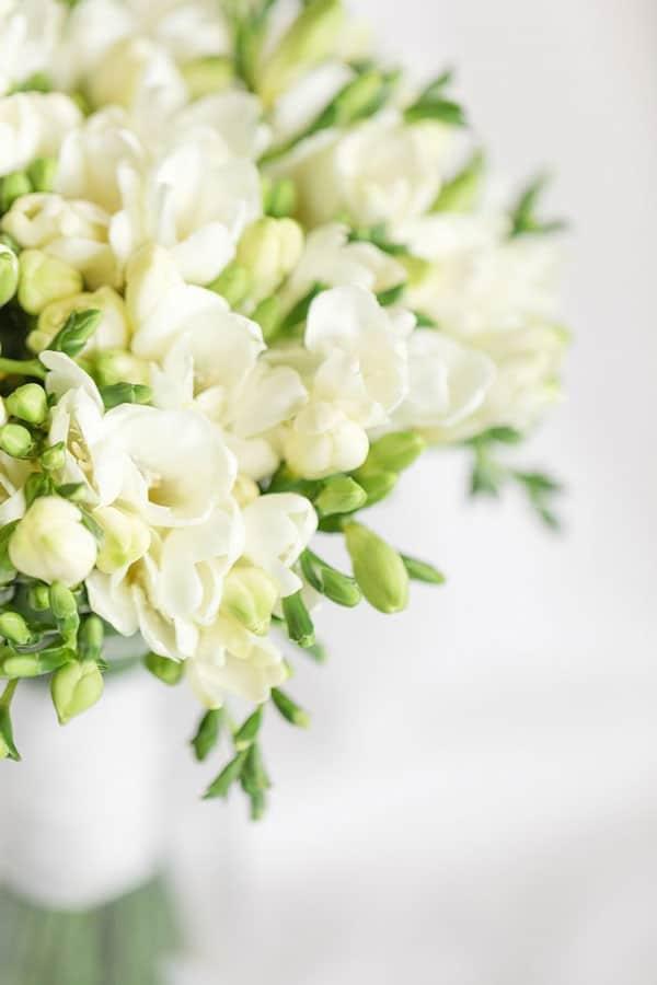 lovely white Fressias wedding bouquet