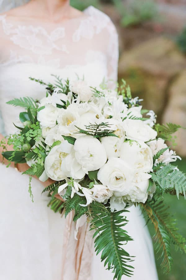 Camellia's used in white winter wedding bouquet